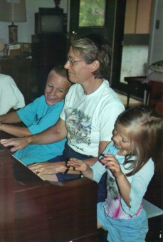 Pam playing piano with Alex & Elise - 2003
